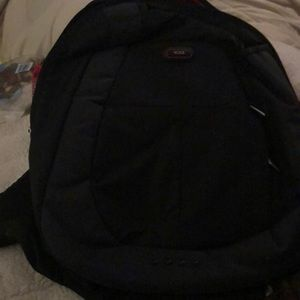 Tumi black backpack